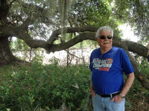 Terry Hadley standing next to an oak tree that was preserved on the farm.